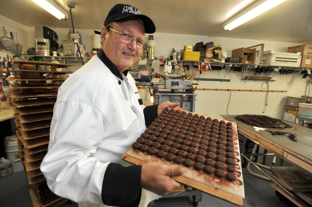 6037593 bytes; 4256 x 2832; DENNISPORT-- 08/20/14-- Ray Hebert at Stage Stop Candies works with a batch of dark chocolate truffl